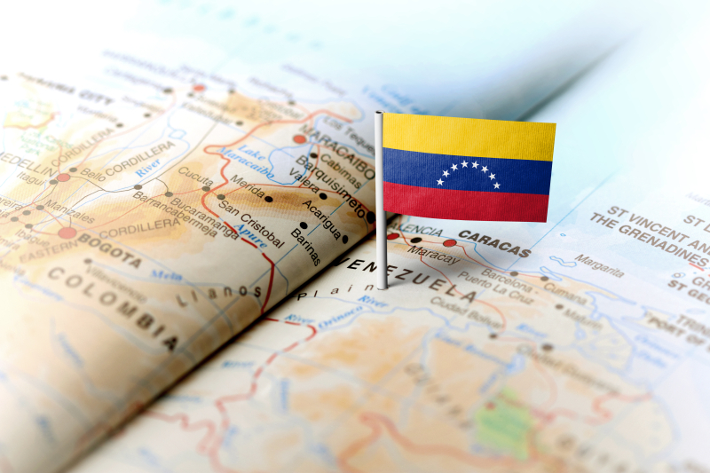 Venezuela pinned on map with flag_iStock-583795412